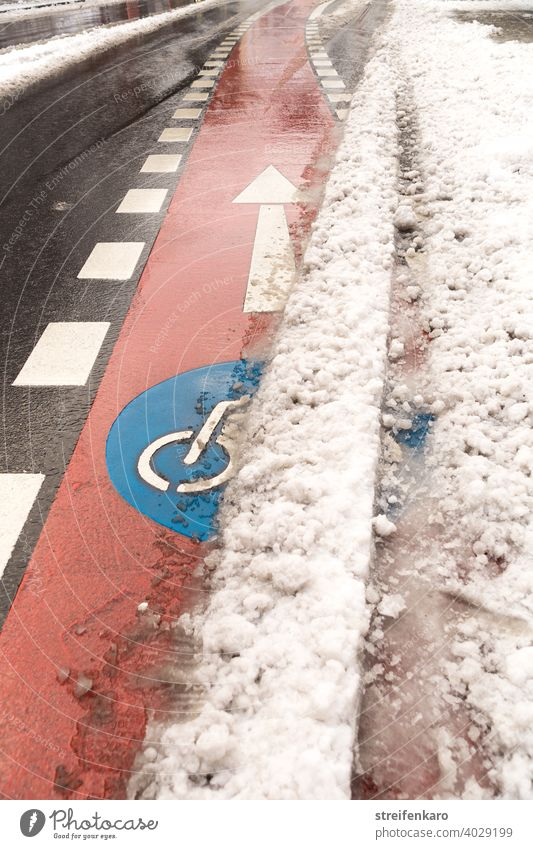 Clear ahead! - Red bike lane pushes out from under the snow ride a bike ride a bicycle Winter Snow Street Blue symbol Transport Driving Bicycle