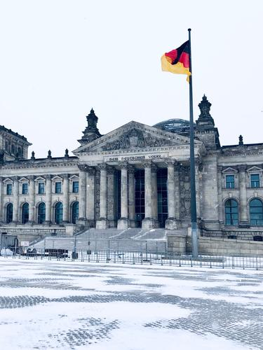 he VOLK los | Reichstag building Berlin in winter with snow, without people Germany German flag Bundestag Deserted Government cordoned off safeguarded