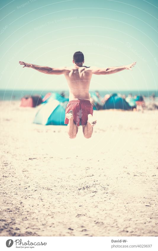 Happy on a summer day at the beach Skip vacation Summer vacation Beach Vacation mood Ocean Joy Happiness happy Jump muscle Man