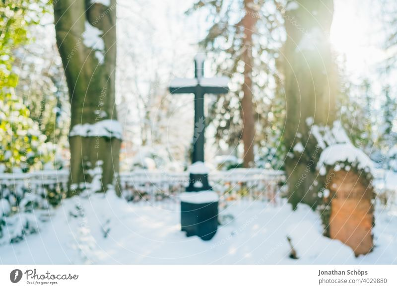 Grave in cemetery in winter with snow death and eternity Goodbye Funeral bokeh Christianity Coronatote Corona winter Eternity Cemetery Prayer commemoration