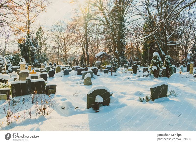 Grave in cemetery in winter with snow death and eternity Goodbye Funeral Coronatote Corona winter Eternity Cemetery Prayer commemoration Belief God God'sack