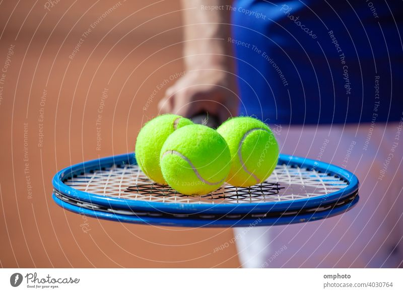 Tennis Player with Racket and Balls tennis sport racket ball court clay competition activity serving service game set professional play action player match man