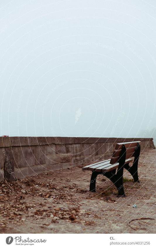 unpromising Bench Park bench Seating Wall (barrier) foggy Gloomy dreariness Loneliness silent tranquillity melancholy forsake sb./sth. Empty Wooden bench Winter