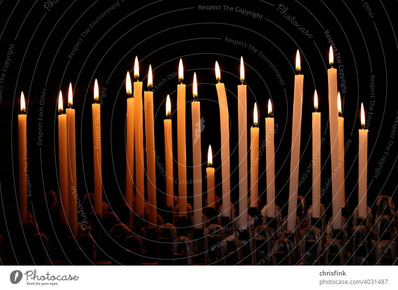 Candles in row against dark background candles Light Shadow darkness Illuminate brightness Church Church service Fear Grief God Christianity Jesus Flame