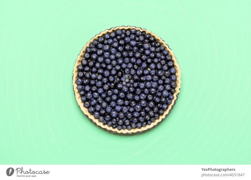 Blueberry pie, uncooked, isolated on colored background, top view. Baking pie at home 4th july above view american bake bakery baking bilberries