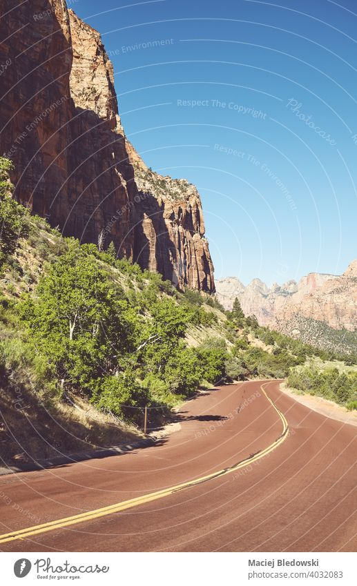 Scenic road in Zion National Park, retro color toning applied, Utah, USA. valley travel trip nature park scenery mountain wanderlust canyon cliff national park