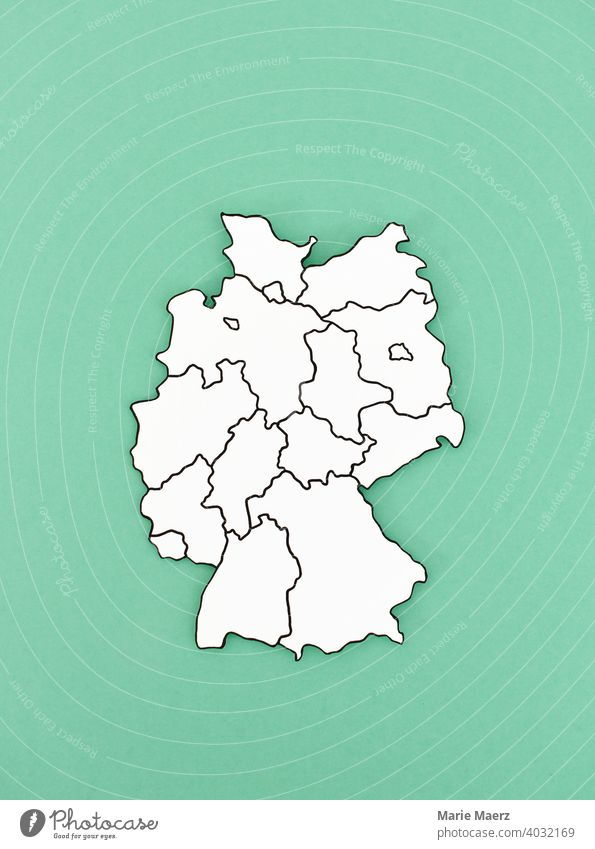 Paper map of Germany with federal states marked on it States Map frontiers Abstract Minimalistic Neutral Background country paper cut Illustration outline
