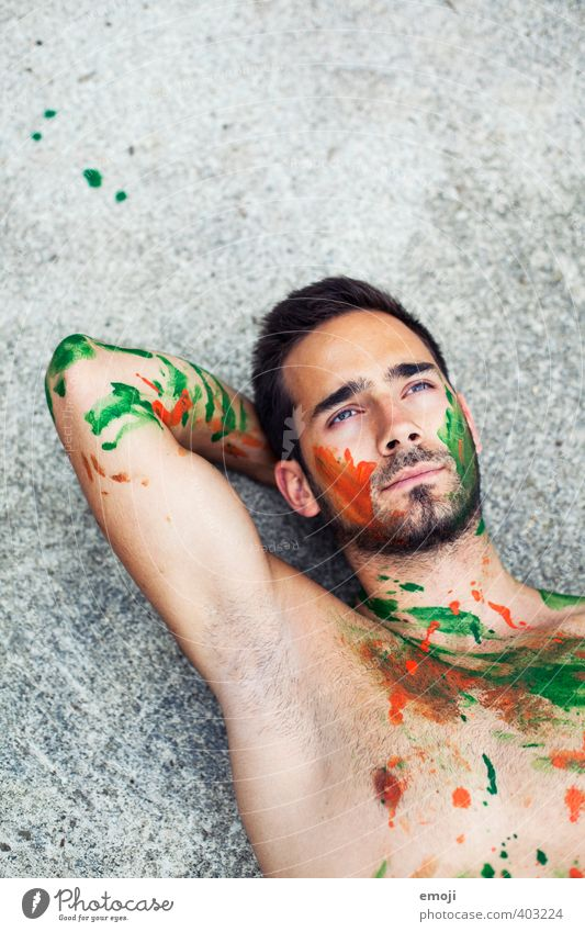green-orange Masculine Young man Youth (Young adults) Body 1 Human being 18 - 30 years Adults Uniqueness Bodypainting Lie Colour photo Exterior shot