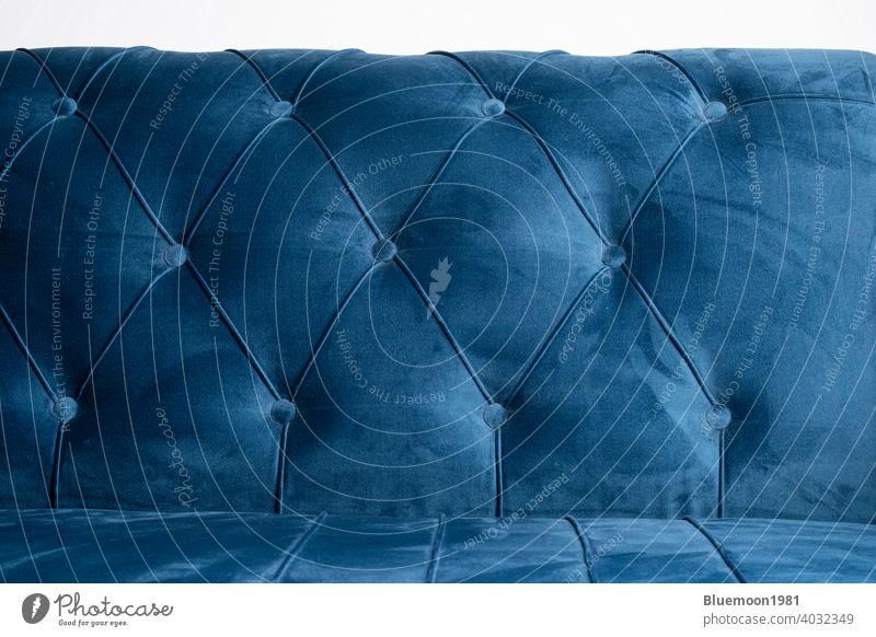 Blue velvet couch background texture with sunken buttons sofa soft color comfortable cozy cushion elegance fabric material object ornate pattern relax shape