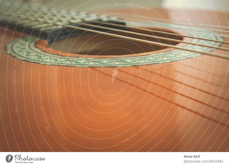 Part of a guitar. Guitar Music Musical instrument Musical instrument string Leisure and hobbies Make music Wood Sound String instrument Musician Close-up