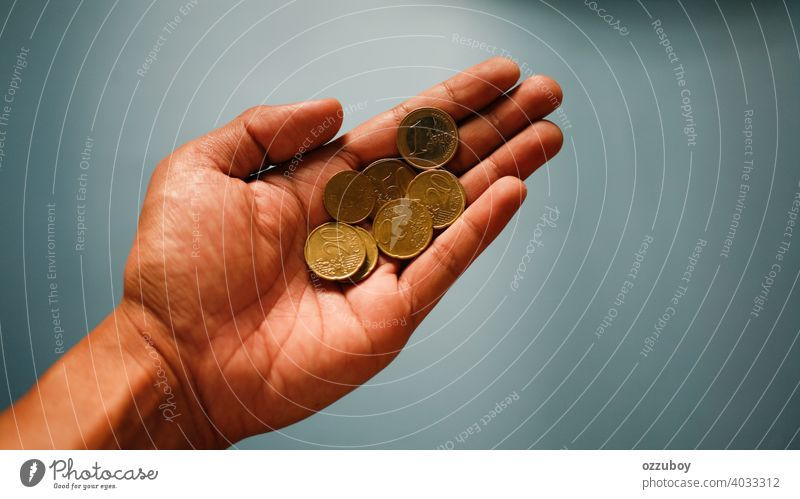 hand holding coin currency finance europe metal business money economy gold investment success wealth background closeup european bank cash cent coins savings