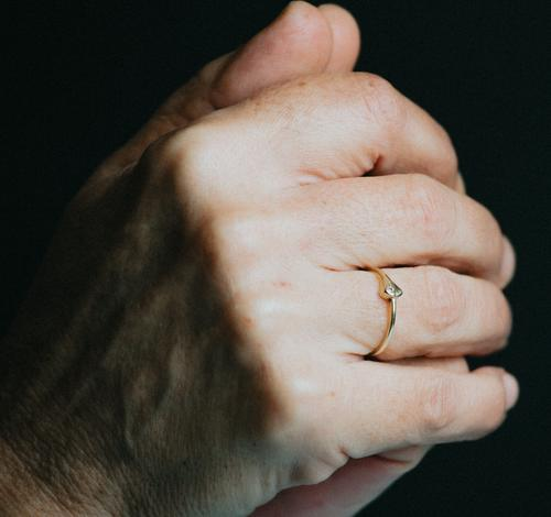 A pair of old hands praying with a luminous ring on the finger, jewelry concept shot person woman diamond feminine fingernail perfection prosperity rich senior