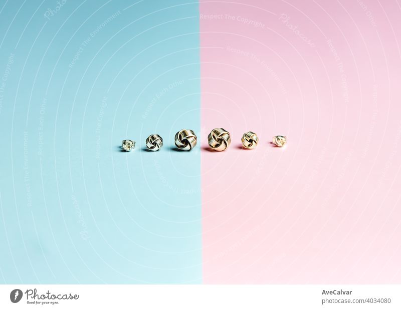 Minimalistic shot of a group of earrings over a pastel pink and blue background jewellery gold jewelry luxury crystal stylish expensive glamour necklace pair