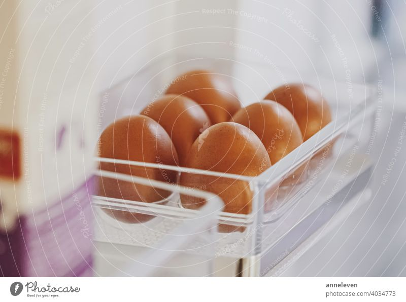 fresh eggs in refrigerator, dairy product authentic box breakfast brown carton chicken cinematic closeup cooking copyspace diet easter farm food fridge healthy