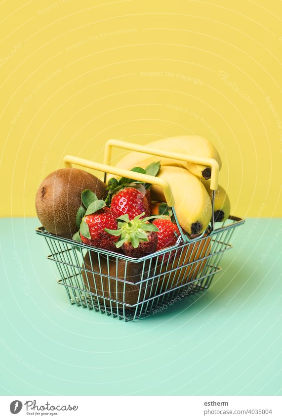 Shopping basket with fresh fruits shopping basket strawberries oranges bananas kiwis nutritional object freshness copy space ingredients diabetes farm summer