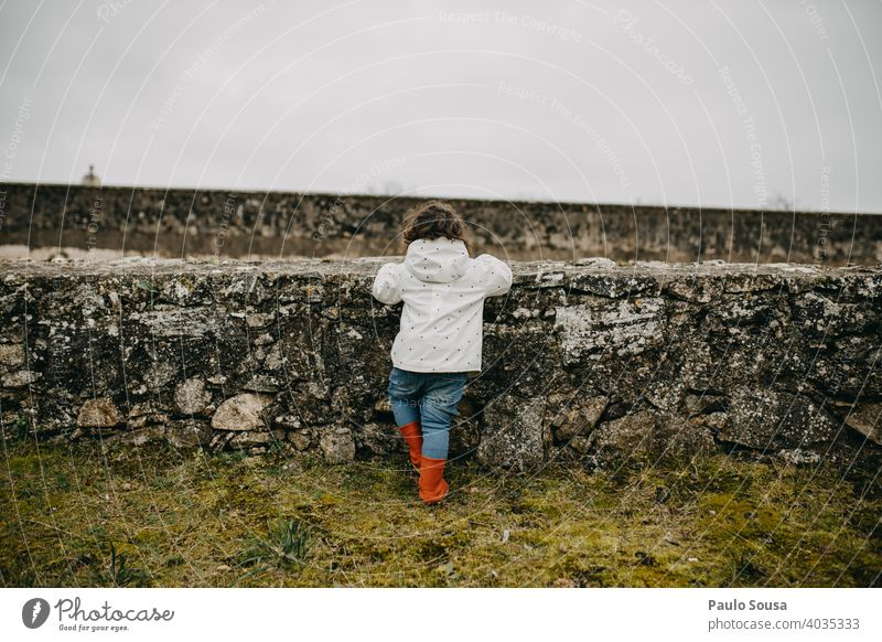 Rear view child looking through walls Child childhood Caucasian 1 - 3 years Colour photo Copy Space Infancy Human being Lifestyle Toddler Joy