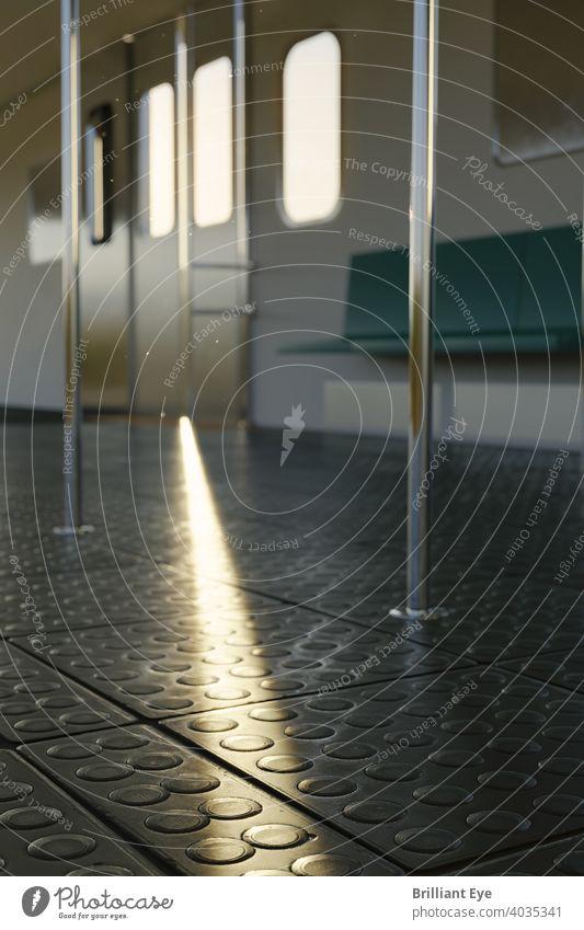 Train compartment in the evening with sunbeam on rubber floor background Window voyage Trip cabin Sunlight Architecture Stick urban Underground nobody Seat