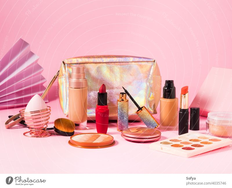 Make up cosmetics products on pink and beauty bag makeup lipstick valentine background shopping foundation make up brush display professional face nude flat lay