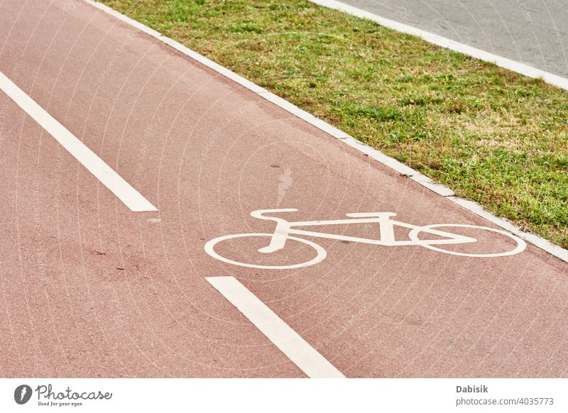 Empty bicycle path in city street bike lane road track symbol sign urban cyclist transport outdoor asphalt transportation exercise biking travel wheel paint