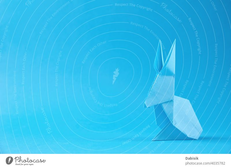 Paper origami Esater rabbit on a blue background. Easter celebration concept easter bunny holiday animal decoration spring happy paper cute art colorful