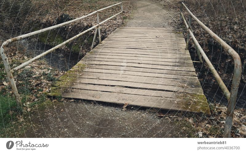 Weathered old wooden bridge with rusty railings weathered damaged park path way walking parkland nature leisure outdoor landscape travel water river forest