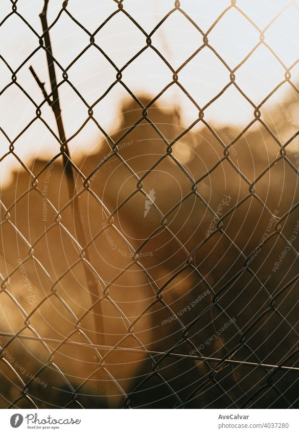 Fence during a colorful sunset background, orange and green tones fence sky nature landscape beautiful light farm evening silhouette outdoor summer sunrise