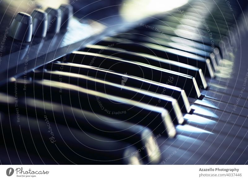Electric piano keyboard in blur. Piano keyboard with day light reflections. acoustic audio background band black blue bokeh child chord classical close up
