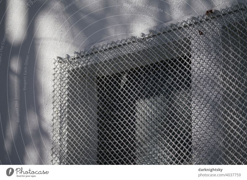 Grille on a window to protect against burglary and theft Grating Safety Light Protection Barrier Exterior shot Deserted cordon Metal Structures and shapes