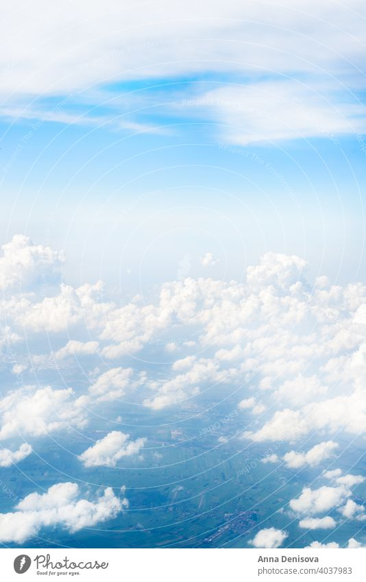 Skyline View above the Clouds from Airplane sky airplane cloud view blue window white high travel fly beautiful background horizon space flight atmosphere