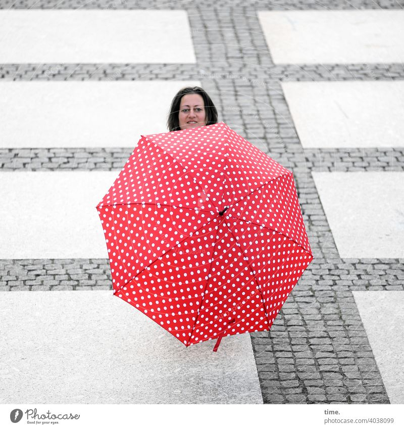Woman behind umbrella ahead Umbrellas & Shades Head Hide Places Stone path inquisitorial Smiling lines Red Whimsical Sunshade