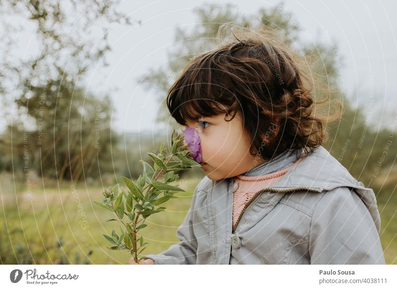 Child smelling wild flower childhood 1 - 3 years Caucasian Curiosity Education Life Happy Playing Day Childhood memory Leisure and hobbies Colour photo