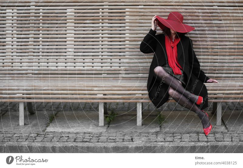 lady rocks the bench Woman Bench Hat Red Black heels Scarf urban Break Sit stylish Exceptional stop