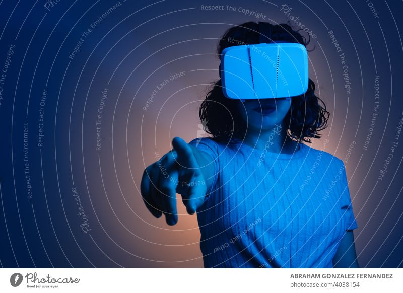 young woman with virtual reality glasses entertainment game device innovation modern technology background helmet futuristic headset digital activity vision