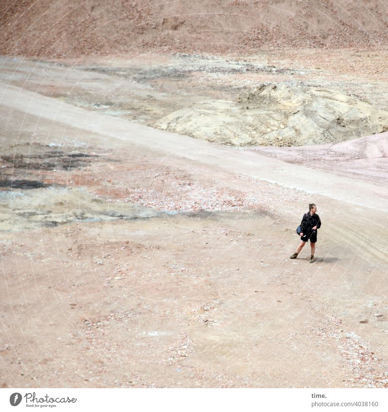 The subject and the photographer Woman Places inquisitorial Stand Observe look around Sand off camera search Earth Construction site Summer on one's own stones