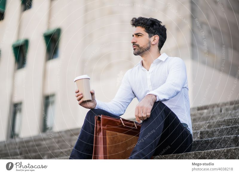 Business man drinking coffee on a break from work. young business cup outdoors street city urban life stylish hold hot career cafe employee outside portrait