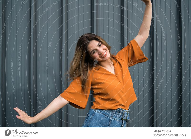 Portrait of young woman outdoors. portrait street celebrate female stylish celebrating urban lifestyle positive celebration outside one adult person casual