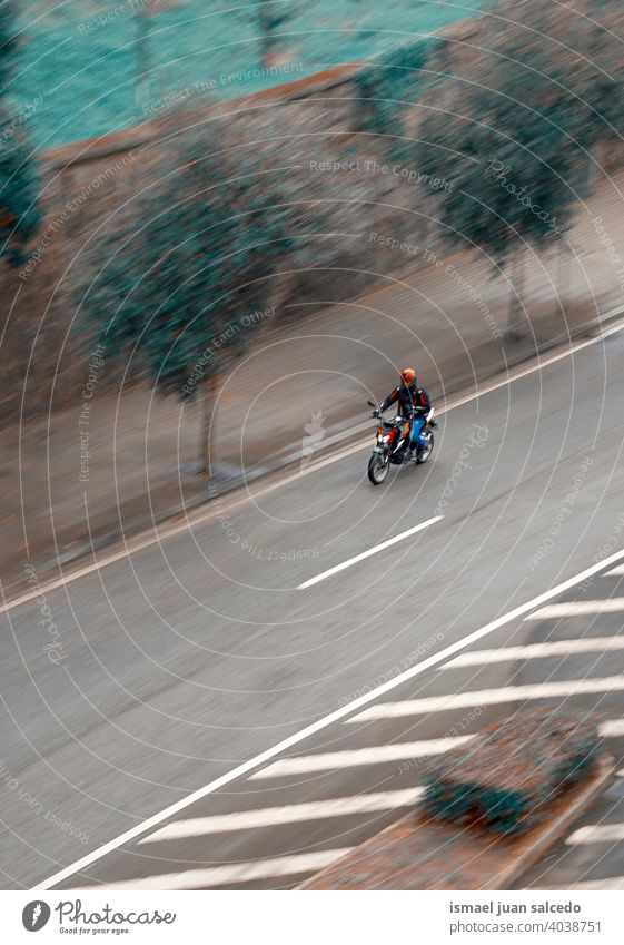 Motorcyclist on the road in the city Motor vehicle Motorcycle Motorcycling Man Drive swift Speed Street street photography Lifestyle Delivery Delivered