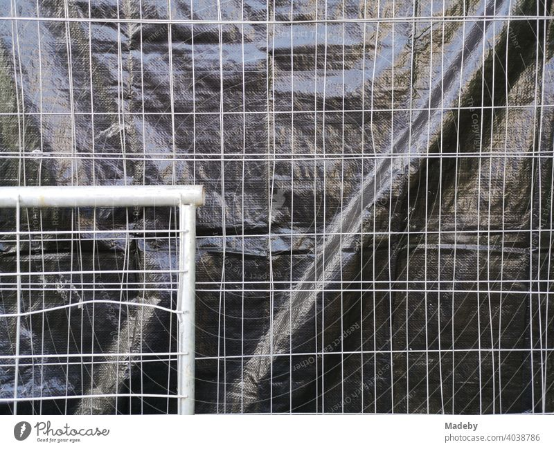 Construction fence made of wire with privacy screen made of black foil at the Goethe University in Frankfurt am Main Bockenheim in Hesse Hoarding cordon