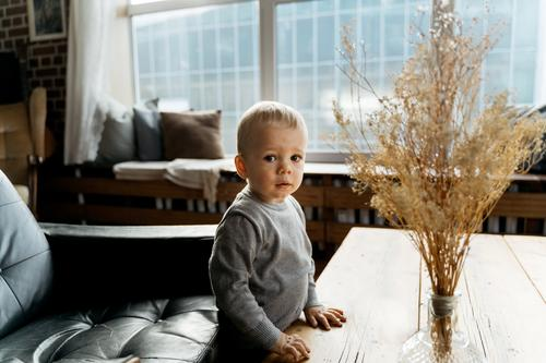 small boy looking at camera adorable baby babyhood blonde boys child childhood cute emotions explore exploring expression family fun happiness happy
