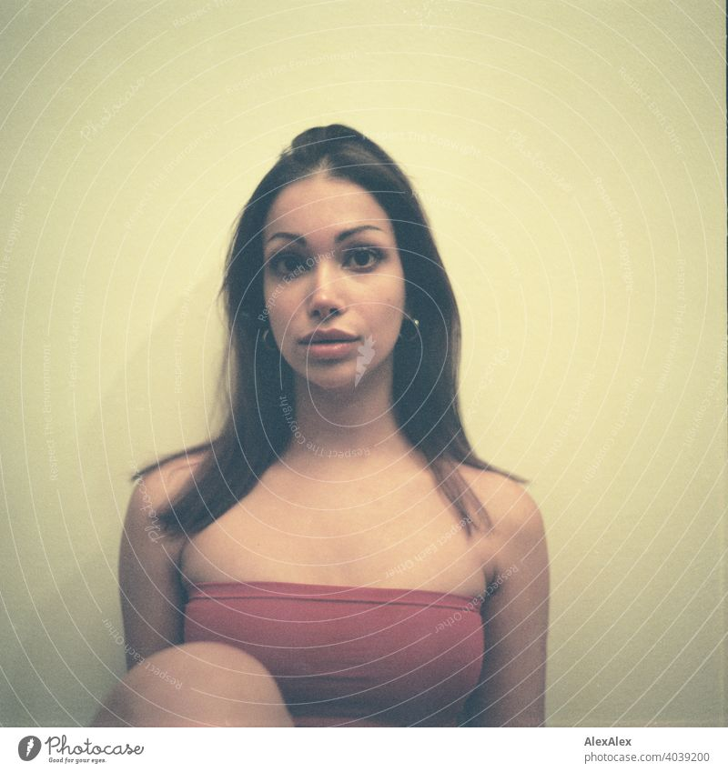 Analogue rectangular portrait of young slim beautiful woman with red top daintily laterally Dark Beauty & Beauty In love décolleté Upward Skin Friends Direct