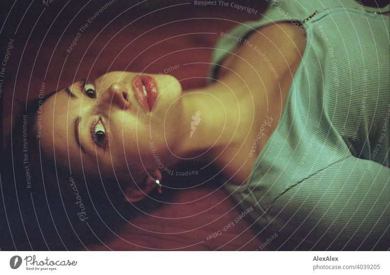 analogue portrait of a young beautiful woman lying on a wooden table teen Face Woman Identity Esthetic grain Love expectant Top Graceful Sportiness overhead