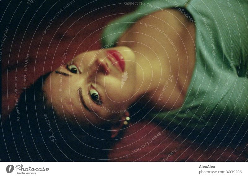 Analogue overhead portrait of a young, slim, beautiful woman lying on a wooden table daintily laterally Dark Beauty & Beauty In love Lie Wooden table décolleté