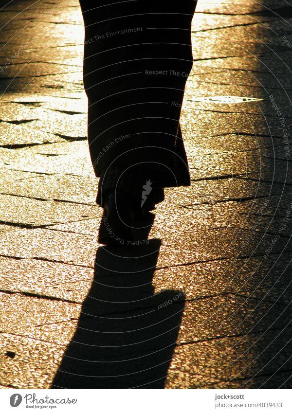 2800 steps on track not quite level Silhouette Dark Contrast Human being Sidewalk evening light Sunlight Shadow play Back-light Pedestrian Paving tiles Uneven