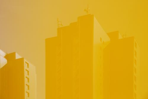 sky yellow, transmission masts yellow, prefabricated building yellow Marzahn Berlin differently Reflection Facade Unicoloured Gloomy Sunlight Tower block Sky