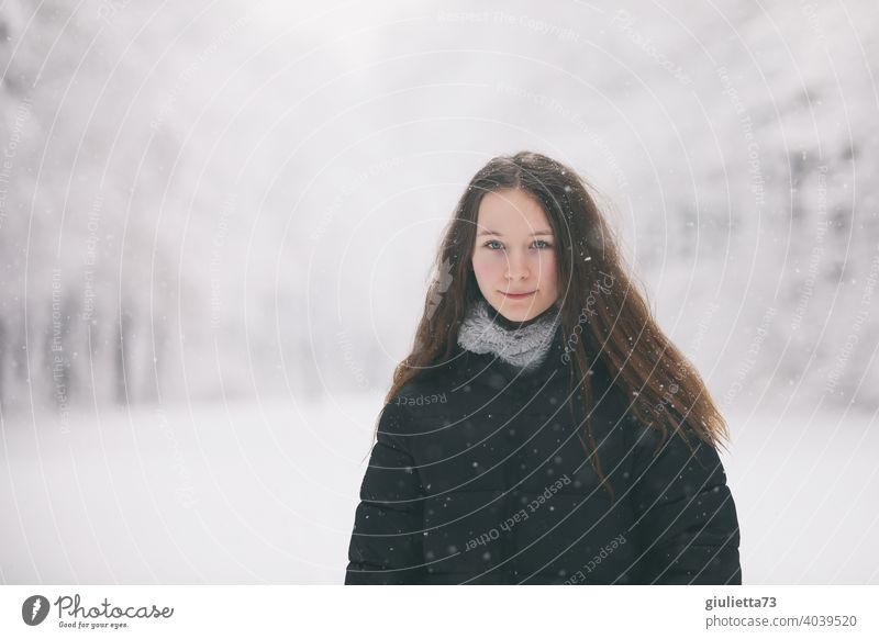Portrait of long haired teen girl in winter snowfall White Feminine snowy Long-haired 13 - 18 years pretty naturally Looking Neutral Background
