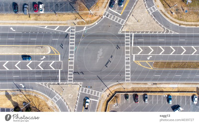 Aerial view of an intersection with vehicles aerial view auto automobile avenue busy car chaos city city street commercial connection crossing crossroad