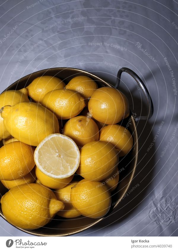 High Angle View Of Citrus Fruits In Bowl On Table Lemons yellow Fresh Citrus fruits Healthy Vitamin C Nutrition Food Organic produce top down Group of objects