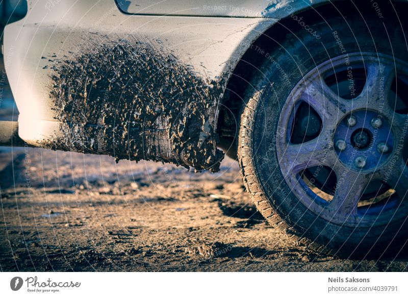 dirt on white car, dirty gravel roads because of spring thaw dirty car car wash abstract asphalt auto automobile background black blue chrome clean close