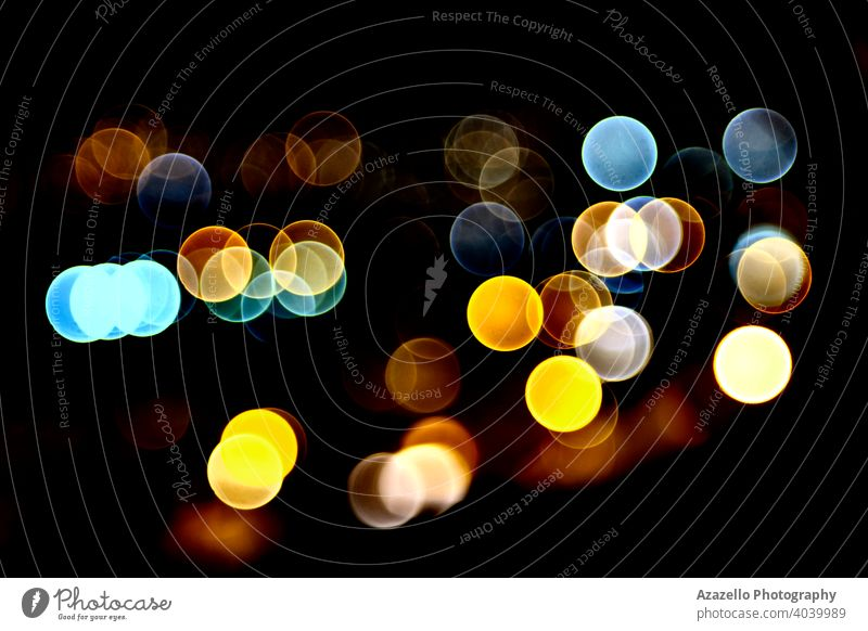 Black background with vivid colorful bokeh circles abstract blur blurred blurry bright celebration christmas colour dark decoration defocused design dot effect