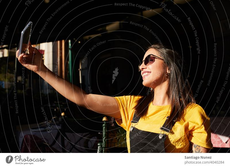 Teenager girl taking selfie at cafeteria. madrid young lifestyle beautiful fun happy leisure woman smiling teen cheerful female youth city pretty outdoors